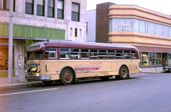"Bill Shapotkin: ""This photo was taken in Kenosha, WI facing east in 57th Street between 6th and 7th Streets. The building behind the bus is still standing today!"" On the other hand, Russ Schultz says this is 56th Street."
