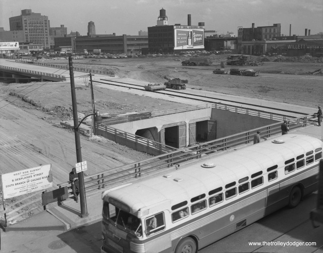"This picture was taken from the old Halsted ""L"" station on the Met main line, which was just north of the Congress Expressway footprint. That station remained open until 1958, when the CTA Congress median line opened. I believe this picture was taken in 1954, but after the end of May, when buses replaced streetcars on Route 8 - Halsted. This section of highway opened in 1955. The two subway portals at right are used by the CTA Blue Line today, but the ones at left were never used. They were intended for use by Lake Street ""L"" trains, if that line had been re-routed onto the highway, and would have connected to a Clinton Street Subway, forming an underground ""loop"" along with the Lake, Dearborn, and Congress legs."