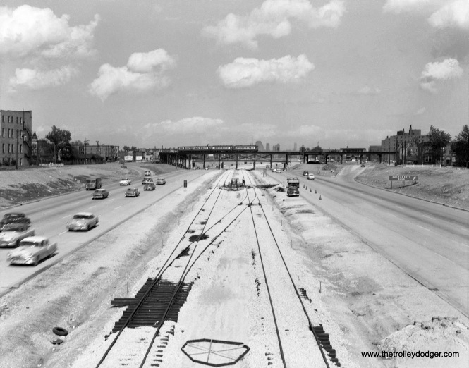 "This is mid-1950s view of the then-Congress Expressway, looking east from Kedzie. We see the new CTA rapid transit line in the median, then under construction, and the old Garfield Park ""L"" in the distance. This portion of the highway opened in 1955 as far west as Laramie. I think this picture may have been taken before the other one in this post."