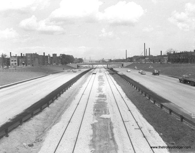 This view of the Congress Expressway looks east from Central Park (3600 W.) towards Homan (3400 W.). On the right, the smokestack closest to the highway belongs to the Garden City Laundry, which was located at 3333 W. Harrison Street, and is mentioned elsewhere in this post. This may be circa 1956, as the highway is open here, but tracks appear to only recently have been added to the median.