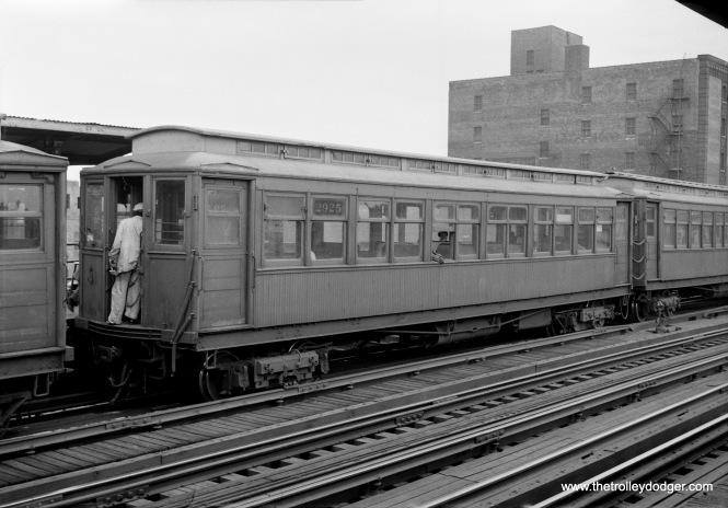 "From 1949 to 1957, the CTA operated the Kenowwd branch of the ""L"" as a shuttle operation, and here we see three such cars at the Indiana Avenue station. By the mid-1950s, the older gate cars had been replaced by ones formerly used on the Met ""L"", as those lines were equipped with more modern steel cars. Not sure why there are three cars here-- Kenwood usually used one or two car trains in these days."
