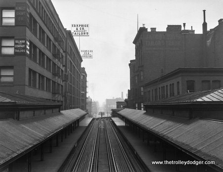 "Elevated train tracks on Van Buren Street, looking west from Franklin Street, 1914. That's the Franklin and Van Buren station, used exclusively by the Metropolitan ""L""."