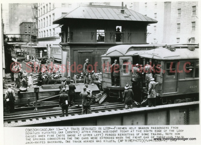 "This and the next picture show the aftermath of an ""L"" derailment at Wabash and Van Buren, which I assume took place on May 12, 1942. That's Tower 12."
