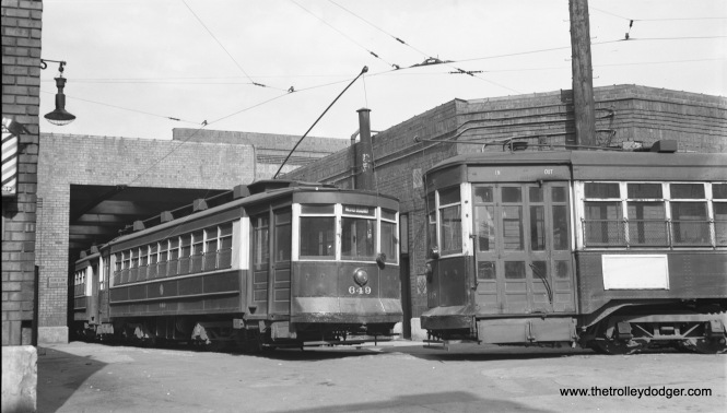 """CTA car 649 on curve leading into south end of Limits barn (Clark and Schubert streets). 6148 at right (October 10, 1953)."" (Robert Selle Photo)"