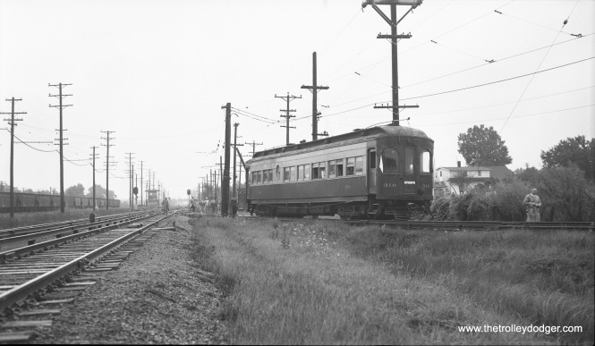 """CA&E Special #310 on the Mt. Carmel line, at the point where it switches off the main line from Chicago to Wheaton, IL (photo stop)."" This was a Central Electric Railfans' Association fantrip on August 8, 1954. (Robert Selle Photo)"