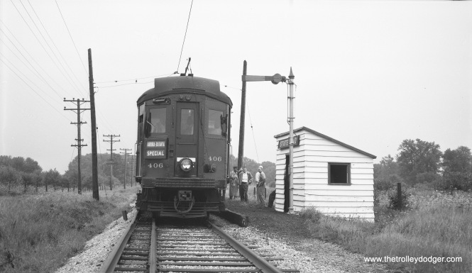 Chicago Aurora & Elgin 406 makes a photo stop at State Road on the Batavia branch on August 8, 1954. The occasion was a Central Electric Railfans' Association fantrip. (Robert Selle Photo)