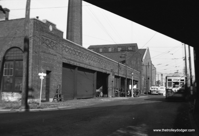 The back end of the West Towns car barn in Oak Park. The street sign identifies this as North Boulvard and Cuyler. This is undated but could be 1939. The Chicago & North Western embankment is just to the right out of view. After being used for buses into the 1980s, this building was demolished and replaced by a Dominick's Finer Foods store. After that chain went out of business, that building was remodeled into Pete's Fresh Market. We are looking to the northeast.