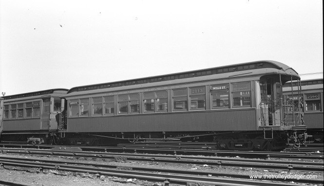 "CTA Met car 2113 at Laramie Yard in August 1948. Don's Rail Photos: ""2104 thru 2154 were built by Pullman in 1894 as M-WSER 104 thru 154. In 1913 they were renumbered 2104 thru 2154, and in 1923 they became CRT 2104 thru 2154."" This would have been one of the original cars used on the Metropolitan West Side Elevated when it opened in 1895."