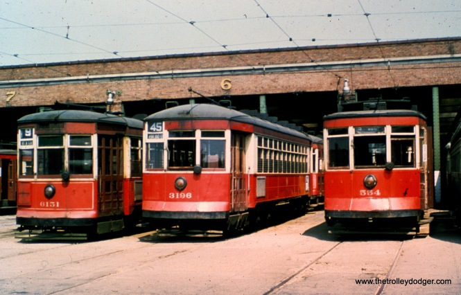 "CTA 6151, 3196, and 554 at 69th and Ashland. M.E.: ""Route 45 was the Ashland-Archer-Clark route, similar to route 42, Halsted-Archer-Clark, but different in that route 45 always used old Pullmans whereas (at this time) route 42 used postwar PCCs."""