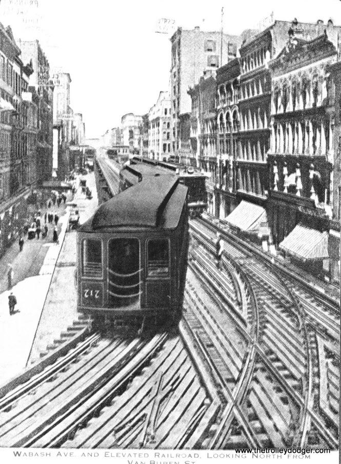 An early Loop photo looking north from Tower 12 at Wabash and Van Buren. I think this is pre-1913, meaning it's the left-hand-running bi-directional Loop. The Met car at left is going away from us on the Inner Loop, while that is probably a South Side car coming towards us, heading south.