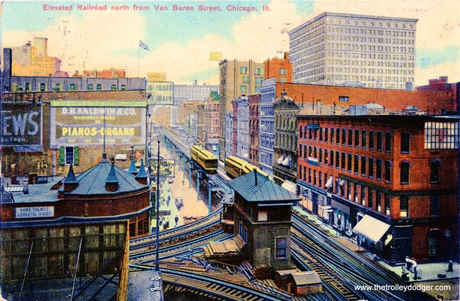 "Tower 12 at Wabash and Van Buren, looking north, in the early 900s. This is during the era when trains ran bi-directionally, left handed, prior to 1913. A Northwestern ""L"" train is turning behind Tower 12 and will head west. The train at left is heading north."
