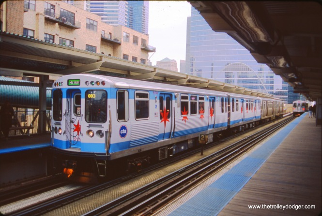 Bruce C. Nelson took this photo of CTA 5174, wrapped with the Chicago flag, on April 24, 2018 at Clinton just west of the Loop.