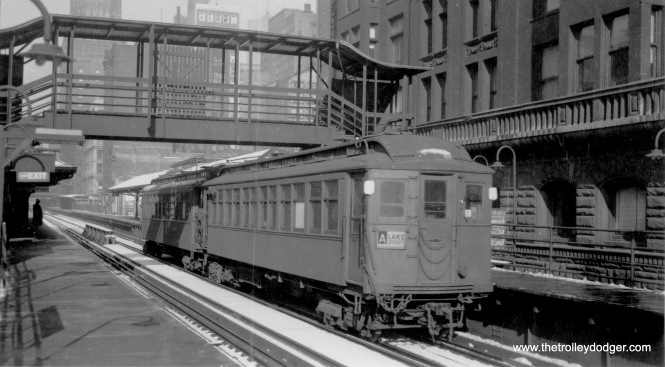 "One of the two cars in this Lake Street ""L"" train is 1708. At Madison and Wells."