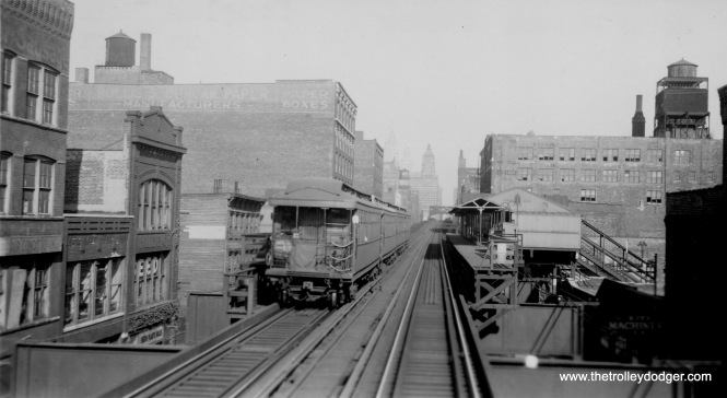 "A westbound Douglas Park train at Halsted on the Lake Street ""L"". Douglas trains were rerouted downtown via Lake from 1954 to 1958."