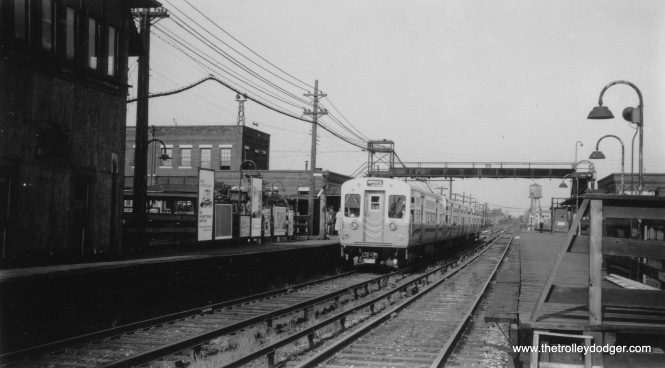 A train of CTA 6000s is westbound at Laramie Avenue on the Garfield Park line in the 1950s.