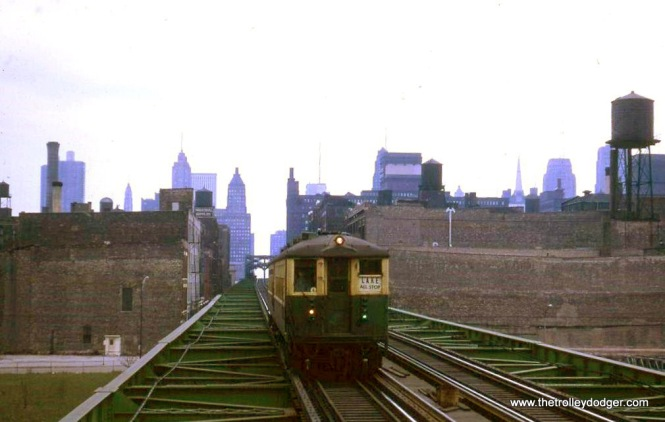 "An eastbound two-car train of CTA 4000s on the Lake Street ""L"" in 1964."