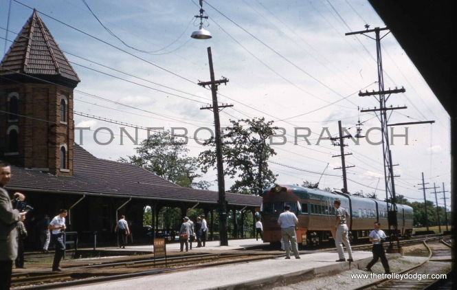 A North Shore Line train stops at Zion, illinois for a photo stop in June 1961. The religious community here made the interurban put in a much larger station than ridership required, because they believed their community would grow rapidly.