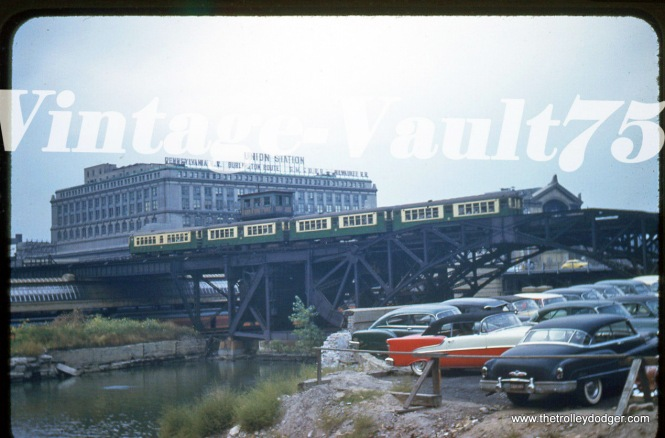 "Kodak did not stamp the processing date on slides until around 1958, but this appears to be around 1955 from the autos. The Garfield Park ""L"" crossing over the Chicago River near Union Station. We are looking to the northwest."