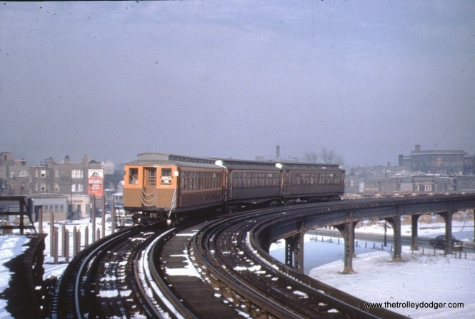 "A westbound Garfield Park train at Sacramento. You can see the beginnings of the temporary ramp at this location, which connected to the ground-level right-of-way used in Van Buren Street from 1953 to 1958. That was north of the old right-of-way. Sacramento was one of two points where the old ""L"" crossed the right-of-way of the Congress Expressway, then under construction."