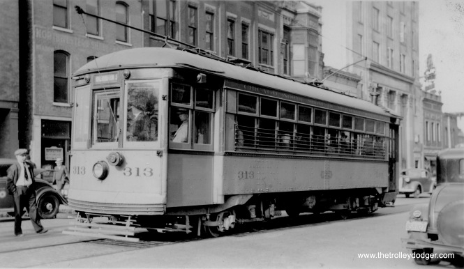 "The North Shore Line interurban operated city streetcars in Milwaukee and Waukegan. Here's what Don's Rail Photos tells us about this car: ""313 and 315 were built by St. Louis Car in 1915 as 313 and 315 of the Empire State Ry for service in Oswego, NY. After only two years, they were sold to the North Shore in June 1918. 313 was rebuilt to one man service on March 12, 1919, and retired in 1941. 315 was rebuilt on February 24, 1919, and retired in 1940. Both were scrapped in 1945."" Don Ross adds, ""North Shore 313 was taken at Waukegan. I don't think it never ran in Milwaukee. We had the 2 door Birneys and 2 350s in Milwaukee until Waukegan quit. We got the 250s and the Birneys were dumped. The 500s were for Milwaukee but switched to Waukegan when the Birneys came."""