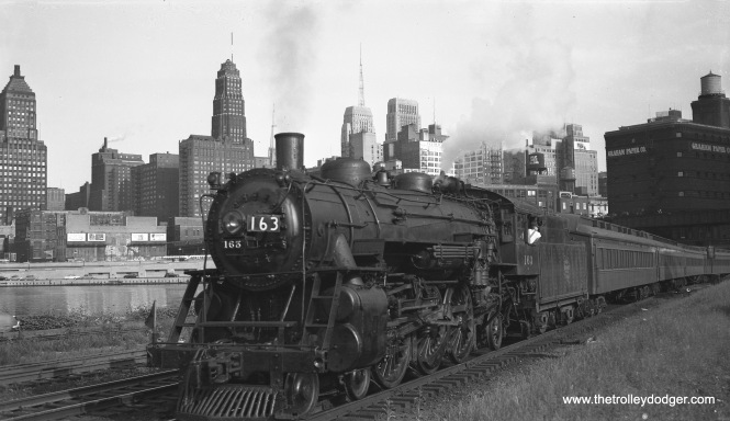 Robert Selle captured this picture of Milwaukee Road steam locomotive 163 (4-6-2) pulling a commuter train just north of Lake Street in downtown Chicago on August 18, 1953. My family moved to the Mont Clare neighborhood in 1954, and we lived a block from the Milwaukee Road. My mother would hang her wash out to dry behind where we lived, and she told me her clothes were dirtied by the smoke from the steam engines (which were fast disappearing from the scene).