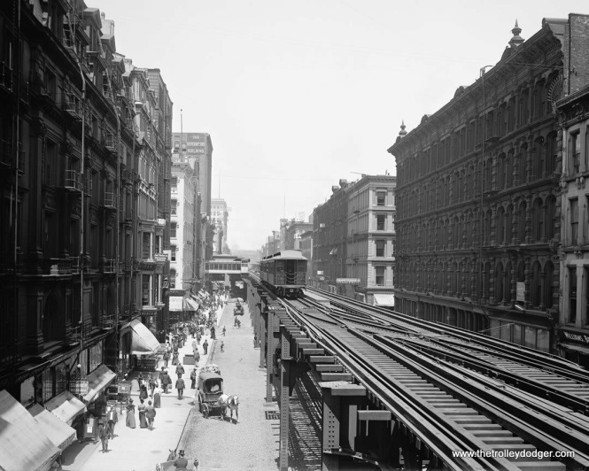 "The Loop ""L"" in 1900, looking north from Adams and Wabash. In the distance, you can see Madison and Wabash in the distance, and what appears to be a direct entrance into a building. Graham Garfield adds, ""Yup—it's the Louis Sullivan-designed bridge to the Schlesinger and Mayer (later Carson Pirie Scott) department store!"""