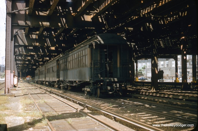 A rare view looking north along the Wilson Avenue Lower Yard in August 1956. Perhaps the final use for these tracks, which were apparently removed in the late 1950s, was to store some old wood cars prior to scrapping. Note some of the cars have broken windows. The back of the McJunkin Building is visible at right. The tracks ended at Wilson Avenue.