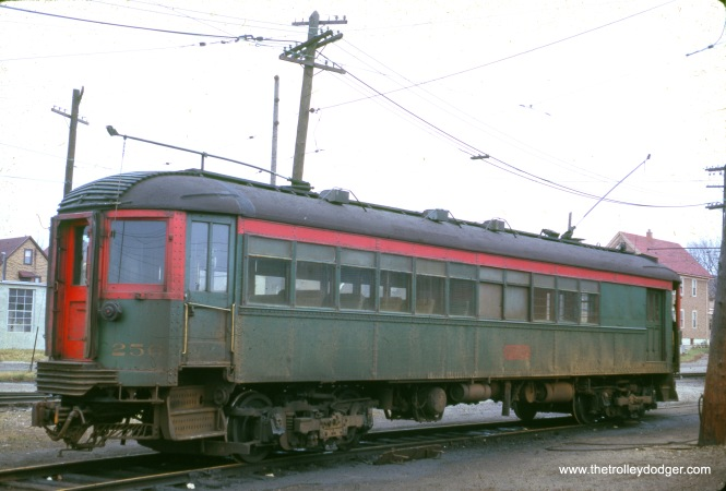 "North Shore Line combine car 256 in Milwaukee in November 1962. Don's Rail Photos: ""256 was built by Jewett in 1917. It seems to be the only one which retained its original configuration."" There is a very similar photo on Don Ross's web site attributed to Joe Testagrose, but it doesn't seem quite identical to this one. If not taken by him, it was probably someone standing next to him, which happens more often than you might think."