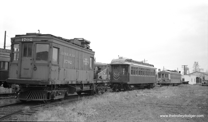 "From left to right, at the Illinois Electric Railway Museum on October 25, 1958, we see Illinois Terminal line car 1702, CRT/CTA ""L"" car 1024, and Milwaukee streetcar 972. This is when the museum was at North Chicago. Don's Rail Photos: ""1702 was built by Danville Ry & Light Co in 1903 as 1507, a pull car. It was rebuilt as a line car in 1922 and renumbered 1702 in August 1925. It was purchased by Illinois Electric Ry Museum on October 11, 1958. 1024 was built by Pullman in 1899 as NWERy 24. It was renumbered 1024 in 1913 and became CRT 1024 in 1923. It was rebuilt as 1st S-111 on March 19, 1955, and sold to Illinois Railway Museum as 1024 in 1958. 972 was built by St Louis Car Co in 1927, #1466. It was purchased by IRM in 1958 and was operated frequently."" (Bob Selle Photo)"