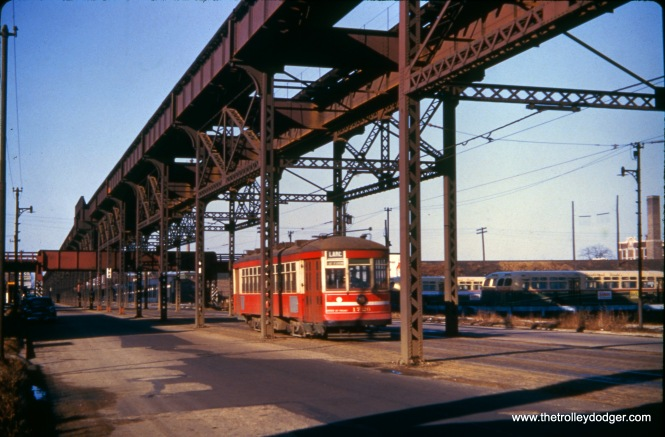 "This is an improved version of an image we previously posted with the following caption: CSL 1786 under the Lake Street ""L"" on November 23, 1952. Note the Chicago Motor Coach yard at right. CMC's assets had been purchased by CTA a few months earlier, and were gradually being integrated into regular CTA operations. Bill Shapotkin adds, ""This pic is actually at Lake/Kenton (not Cicero). The car is E/B. This is the only such photo I have ever seen at this location."""