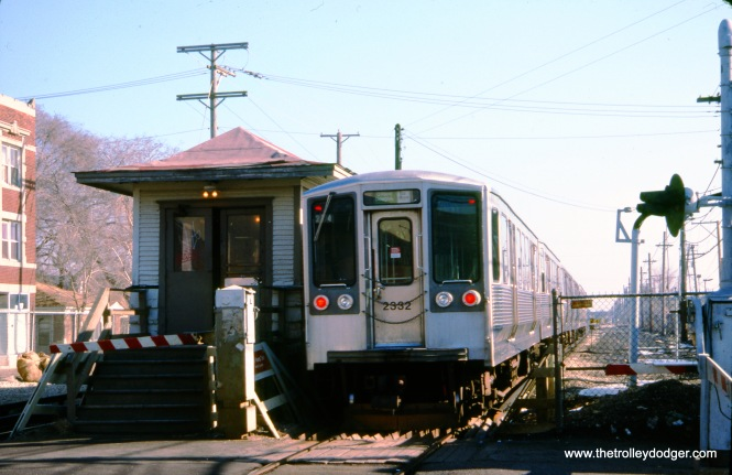 "CTA 2332 and train at Laramie on the Douglas Park ""L"" (now the CTA Pink Line) on February 8, 1991. (Peter Ehrlich Photo, © 2020 Peter Ehrlich)"