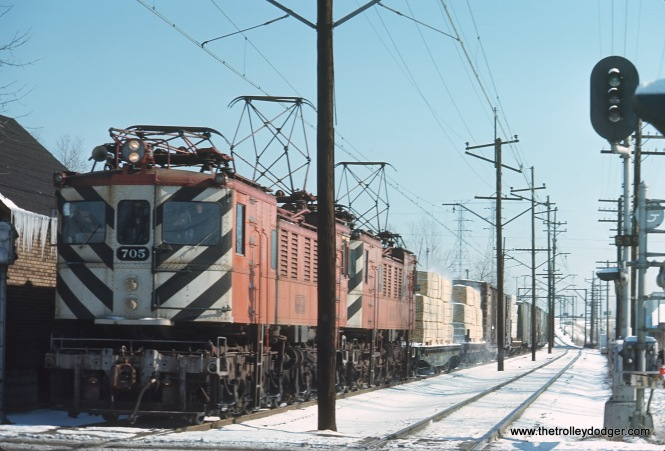 Chicago South Shore & South Bend 705 coming westbound into Hammond. The Indiana Toll Road is in the background in February 1972.