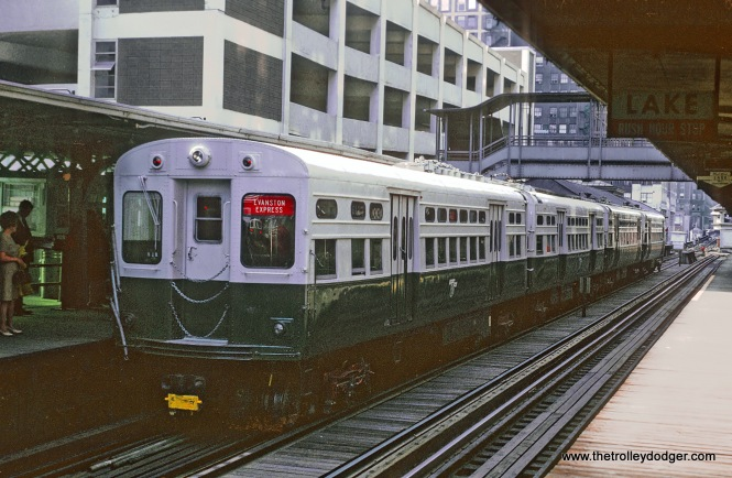 CTA 8127 Evanston Express on Outer Loop at Randolph and Wells Note only one pair of poles -- permanently coupled cars. June 13, 1968