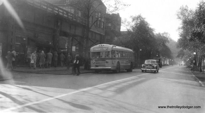 "Chicago Motor Coach 810 63rd & Loomis. Our resident South Side expert M.E. adds, ""This photo, looking south, shows the 63rd and Loomis L terminal before one track was extended out over the street. The auto on the street seems to have huge horns on each side of the hood. I think it is a late 1940s Cadillac. Also interesting is that the bus sign reads ""Marquette Rd. Limited, (to) Washington and Canal."" How did it get there? I found a decent map: https://www.cmap.illinois.gov/documents/10180/213749/ChicagoBoulevardSystem_20120312_version1-0.pdf This route used Loomis Blvd. (1400 W.) between Marquette Rd. (6700 S.) and Garfield Blvd. (5500 S.), where it turned east on Garfield. Beyond that, the route probably turned north on Michigan Ave. (which never had streetcars anywhere north of 95th St.), then all the way into downtown."