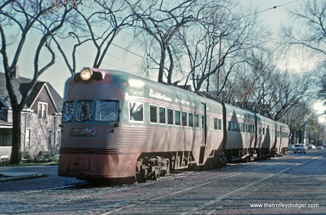 An Electroliner on the Milwaukee Streets -- 4 Photos I don't know how Roger Puta did it, but he photographed the same northbound Electroliner both on 5th and 6th Streets on October 21, 1962 only a couple blocks apart. Here are his captions. CNS&M Train 805, The Electroliner on S. 5th St. near W. Orchard St.