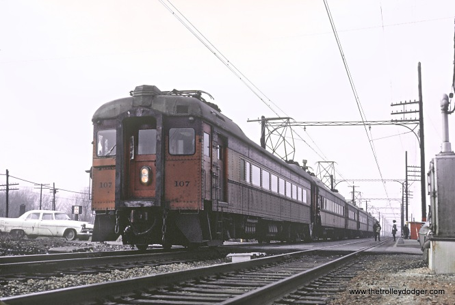 CSS&SB 107 eastbound at the Hegewisch stop in Chicago, IL on December 31, 1965. (That's my wonderful Plymouth. Roger and I were in our senior year of college.)
