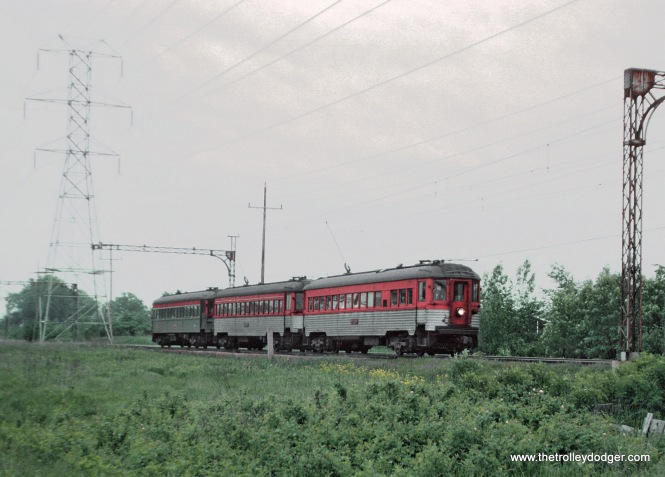 CNS&M Train 409 northbound south of the Northbrook, Illinois station on the Skokie Valley Route on May 26, 1962.