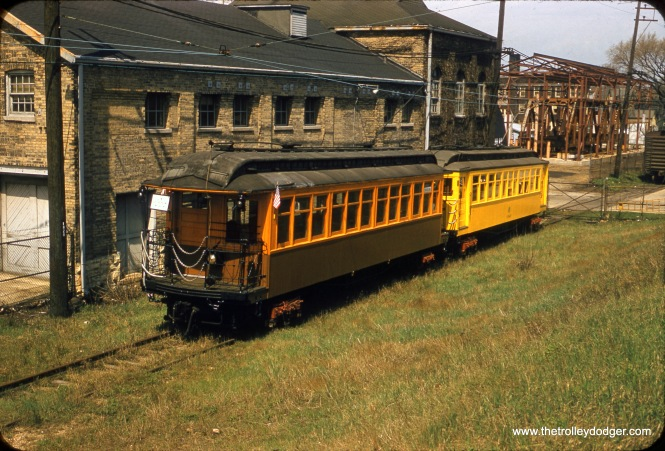 "CTA 1024 and work car S-340 were used on a fantrip for the Illinois Electric Railway Museum in August 1958. The location is the old Church Street freight yard near Northwestern University. After the fantrip, car 1024 went to the museum's location in North Chicago under its own power. It has since been restored to its as-delivered appearance as car 24. Don's Rail Photos: ""1024 was built by Pullman in 1899 as NWERy 24. It was renumbered 1024 in 1913 and became CRT 1024 in 1923. It was rebuilt as 1st S-111 on March 19, 1955, and sold to Illinois Railway Museum as 1024 in 1958. S-340 was rebuilt from a 1700 series car."" In this case, the ""rebuilding"" appears limited to a new coat of yellow paint. Information from Andre Kristopans shows that S-340 was originally car 1815, retired on January 9, 1958. It lasted into the mid-1960s."