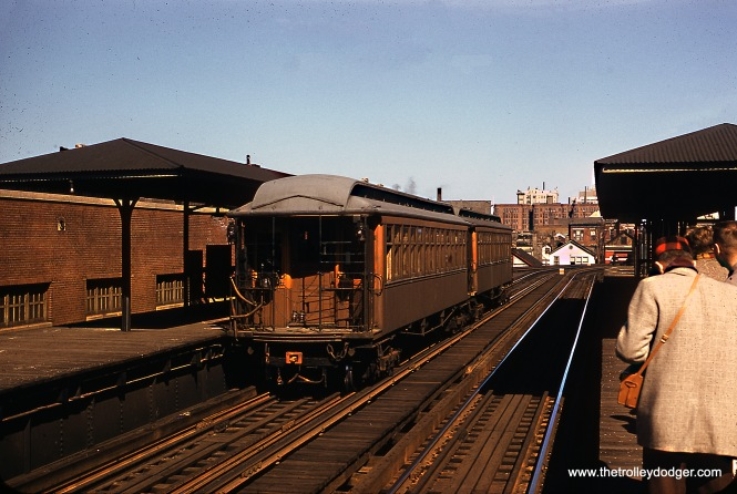 "This is the same fantrip train as in the picture taken at Kimball and Lawrence. Two wooden ""L"" CTA cars, including 390, are posed for a photo stop at Sedgwick in April 1957. The occasion was a Central Electric Railfans' Association fantrip. Many of these trips took place on Sundays, when Ravenswood trains did not run on this part of the ""L"", so there could be leisurely photo stops. At night and on Sundays, the Rave operated as a shuttle, starting in 1949, going only as far as Armitage. In 1963, after the North Shore Line quit, the Ravenswood shuttle ended at Belmont. The shuttle operation ended in 2000, as ridership on the renamed Brown Line had greatly increased. Now all Brown Line trains go to the Loop."