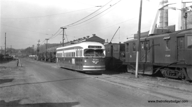 "CTA PCC 7180 is at South Shops on February 12, 1956, near work cars E-208 and F-29. Don's Rail Photos: ""E208, sweeper, was built by McGuire in 1895 as CCRys E8. It was renumbered E208 in 1913 and became CSL E208 in 1914. It was retired on September 27, 1956. F29, plow, was built by McGuire-Cummings in 1924. It was retired on December 14, 1956."""
