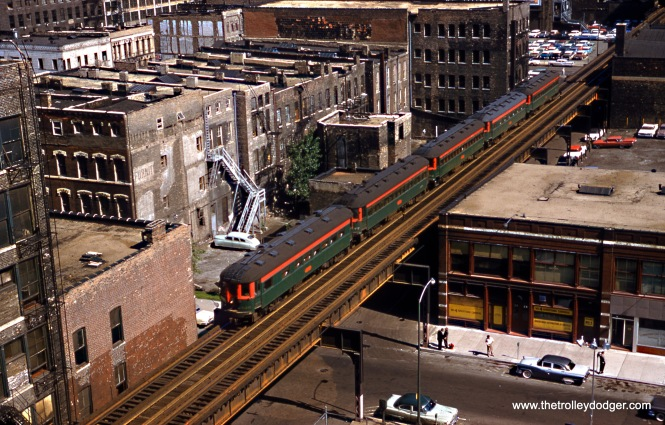 Although this picture was originally identified as Franklin Street, north of the Loop, it's actually at 8th Street, south of the Loop. The clue is the Big 4 Advertising carriers storefront, which was located at 26 E. 8th Street. Thanks to John Suhayda for pointing this out. The head North Shore Line car is 420, and this photo was taken by Robert F. Collins on June 2, 1960. (Wien-Criss Archive)