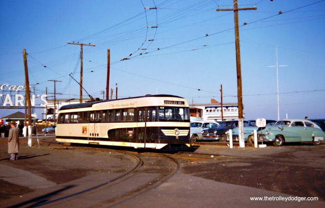 "Atlantic City Brilliner 205 on December 28, 1955. From www.nycsubway.org: ""The third electrified service in Atlantic City lasted longer than the others and it was a streetcar line that made its way from a place called The Inlet at the north end of Atlantic City and operated largely along the city's major thoroughfare, Atlantic Avenue, southward and through the communities of Ventnor, Margate and Longport. Owned and operated by the Atlantic City Transportation Company, this service was distinctive, during its final decade-and-a-half, in that its basic fleet of cars consisted in twenty-five streamlined Brilliners, the Philadelphia-based Brill Company's competitive answer to the PCC car. Other properties purchased small fleets of similar Brilliners, but only in Atlantic City did this unique car serve as the basic rolling stock of a transit system. Until the very end of streetcar service in December of 1955, the Brilliners were supplemented by a small number of conventional Hog Island cars."" So, this picture was taken just off the Boardwalk at The Inlet, near Captain Starn's Restaurant and Yacht Bar, one of the most famous seafood eateries in America in the 1940s, 50s, and 60s. It opened in 1940 and closed in 1979. This was part of a complex offering sailboat rides, speedboats, a fish market, and sea lions. It was featured in the 1972 film The King of Marvin Gardens. (Wien-Criss Archive)"