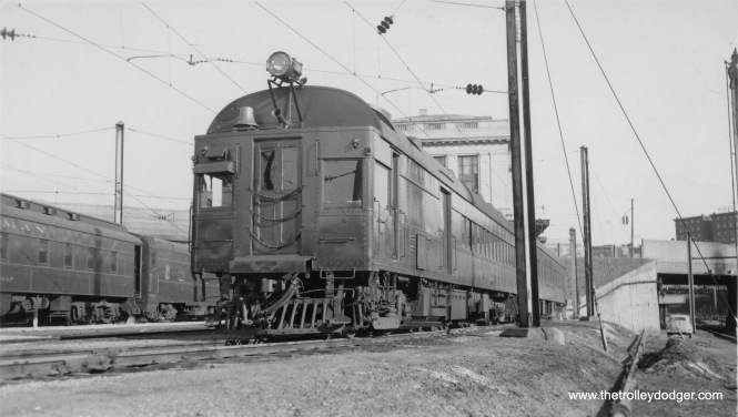 "This picture has been the subject of some discussion on Facebook. It's a Pennsylvania Railroad ""Doodlebug,"" probably after 1948, at Baltimore, MD. It is apparently a Parkton local. John Engleman: ""Actually, actually, it's just sitting in what was called ""the sleeper yard"" at Pennsylvania Station probably between morning inbound and afternoon outbound trips to Parkton. A and B tracks and the platform that served them can be seen just beyond the Charles Street bridge."""