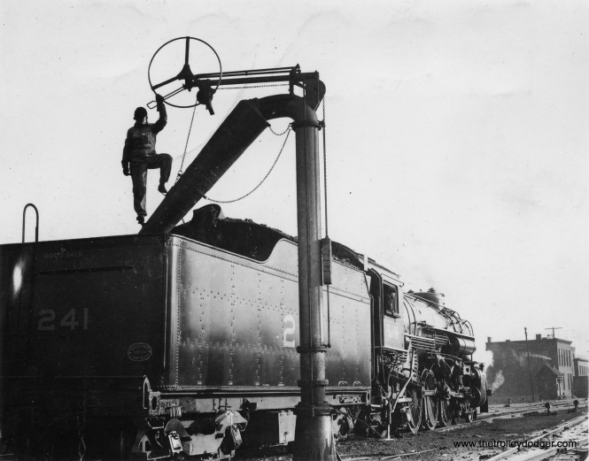 Louisville & Nashville Railroad passenger engine #241, taking water.
