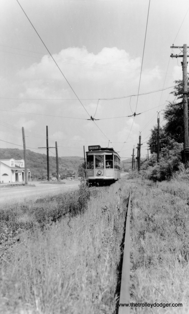 "Pittsburgh Railways at Resee-Charleroi. The car is signed for Riverview. Larry Lovejoy adds: ""The picture of Pittsburgh Railways Company low floor car 3769 is on the Charleroi line northbound at White Barn Siding. The date is 27 July 1952 and the occasion is a fantrip sponsored by the Pittsburgh Electric Railway Club. The line was abandoned ten months later. Today's Pennsylvania Trolley Museum is the direct descendant of PERC and preserves sister car 3756. While ""Riverview"" was a turnback point on the Charleroi line, that destination sign is actually inappropriate at this particular location."""