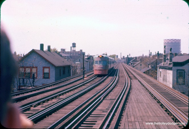 "This circa 1955-58 Ektachrome slide, with the color restored, shows an Electroliner on the four-track section of the north side ""L"". Not sure of the exact location. (J. William Vigrass Photo) Mike Franklin: ""This is looking west from the Sedgwick Station on the North side L. (House to the right is still there at 1542 Hudson Ave.)"""