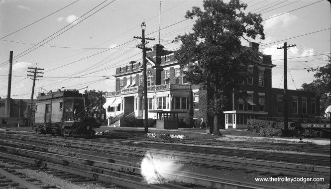 The North Shore Line's headquarters in Highwood, with line car 604 out front. Not sure what caused the lightstruck portion of the neg, but I may try to repair the image in Photoshop at some future date since it is distracting.