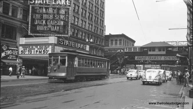 CTA 979 is southbound on State, just south of Lake Street. Romance on the High Seas, playing at the State-Lake theater, was released on June 25, 1948, probably about the time when this picture was taken. The streetcar still has a CSL emblem as this was early in the CTA era.