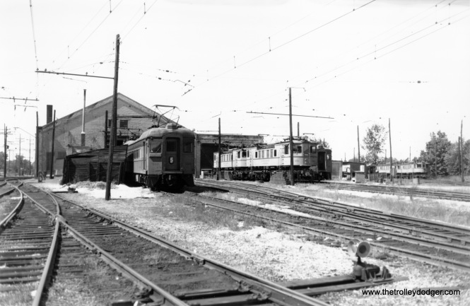South Shore Line car 100 and freight loco 706 are identifiable in this scene that I assume is Michigan City.