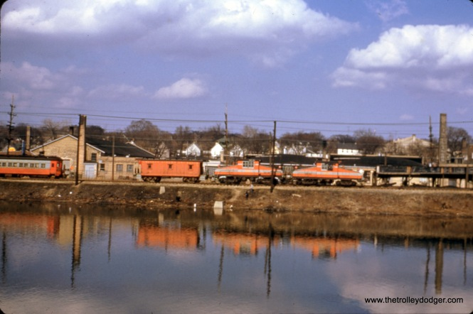 CA&E freight locos 2001, 2002, and a caboose in Elgin on March 30, 1957. A passenger car is also visible.